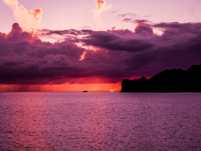 Sunset time at a lagoon. Palau, Micronesia Sky Cloud - Sky Water Sea Sunset Beauty In Nature Scenics - Nature Horizon Over Water Nature Horizon Tranquility No People Tranquil Scene Outdoors Waterfront Idyllic Orange Color Silhouette Dusk Purple