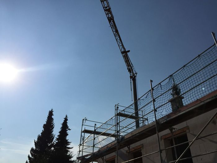 Architecture Blue Sky Building A House Built Structure City Construction Site Crane Day Low Angle View Outdoors Real People Sky