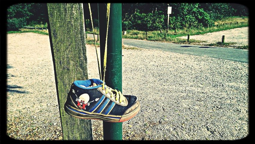 Riding 50 km on my bike, stop for a moment to find directions and find this Children Shoe hanging by it's Yellow shoestring. How Freaky is that? :)