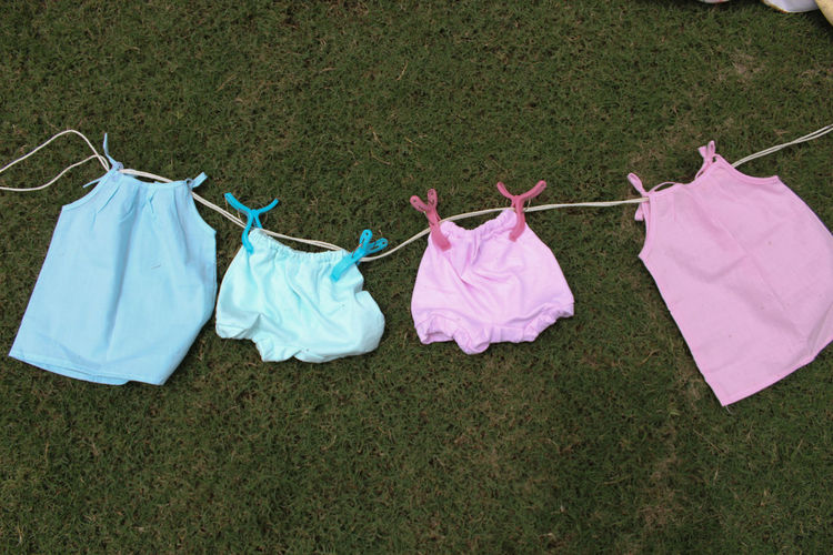 High angle view of clothes and clothesline on field