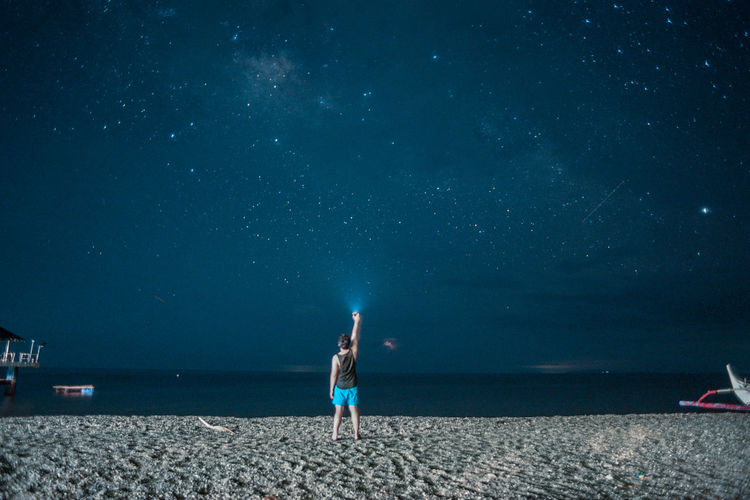 EyeemPhilippines Astronomy Beach Beauty In Nature Full Length Horizon Over Water Lifestyles Nature Night One Person Outdoors People Sand Scenics Sea Standing Star - Space Tranquil Scene Water First Eyeem Photo EyeEmNewHere Capture Tomorrow Capture Tomorrow