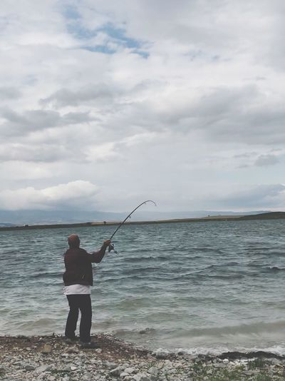 Fisherman Water Sea Cloud - Sky Sky Real People One Person Beauty In Nature Rear View Nature Men Leisure Activity Scenics - Nature Lifestyles Rod Beach Fishing Standing Fishing Rod Day Horizon Over Water The Fashion Photographer - 2018 EyeEm Awards