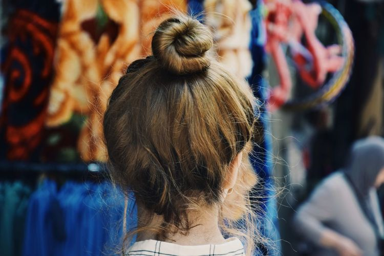 Rear View Of Young Woman Standing At Market