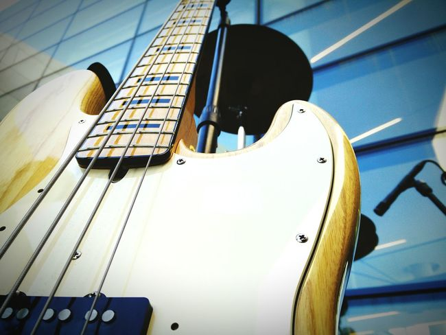 Bass Bass Guitar Bass Player Bassist Blue Close-up Cropped Day Exterior View Modern Musical Instrument No People Part Of String Instrument Wood