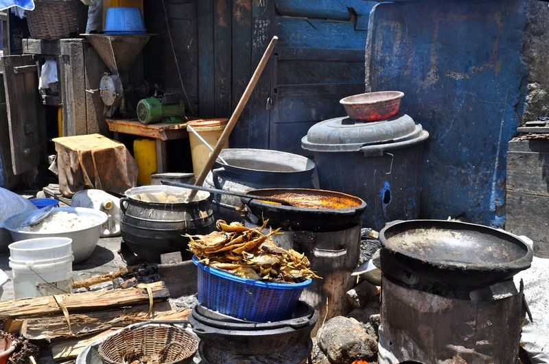 Cooking utensils at outdoor kitchen in village