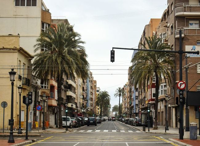 City Wall Building Exterior Day Built Structure Outdoors SPAIN Holiday Cloud - Sky Communication Warning Sign Road Sign Text Palm Tree Traffic Lights