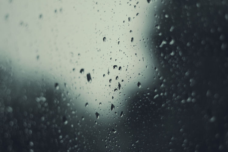 Drop Wet Water Rain Glass - Material Transparent Window RainDrop Full Frame Backgrounds Rainy Season Indoors  No People Close-up Nature Monsoon Vehicle Interior Condensation Glass Droplets Rainy Day Bokeh depth of field Dark Moody Weather