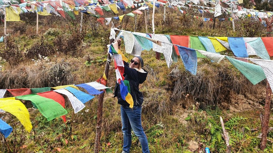 Woman standing by prayer flags