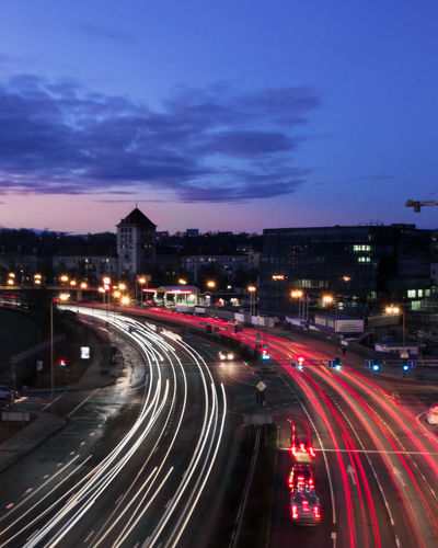High angle view of light trails on road in city