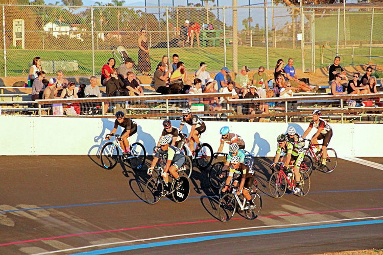 Bicycle racing at the Velodrome. America's Finest City, San Diego, California. Velodrome, Bicycle Racing, Fixed Gear Bike, Bicycle, Riders, Oval Track, San Diego, California, Balboa Park, Morley Field, Evening, Night, San Diego, California, Bay, Harbor, Bridge, Flag, Hotel, Ballpark, Convention Center, Library, Skyline, Pier, Waterfront, Bicyclists Bike Course, Sport