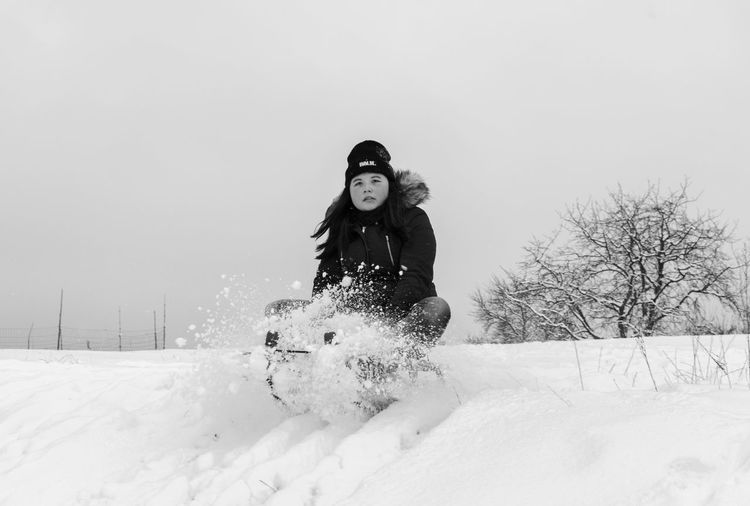 Unexpected Adult Beautiful People Beautiful Woman Beauty Beauty In Nature Blackandwhite Cold Temperature Fun Hat Knit Hat Lifestyles Looking At Camera Nature One Person People Portrait Rural Scene Smiling Snow Vacations Warm Clothing Winter Women Young Adult Young Women Shades Of Winter