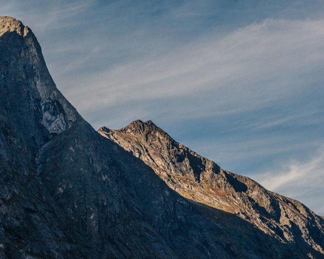 Layered steep rocky mountain