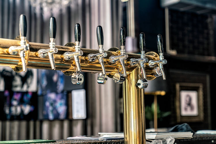 Fresh beer tap on counter bar Beer Beverage Gold Pouring Pub Alcohol Bar Brewery Close-up Cold Craft Detail Drink Equipment Food Fresh Hanging Indoors  Interior Metal Music Pilsner Restaurant Store Tap
