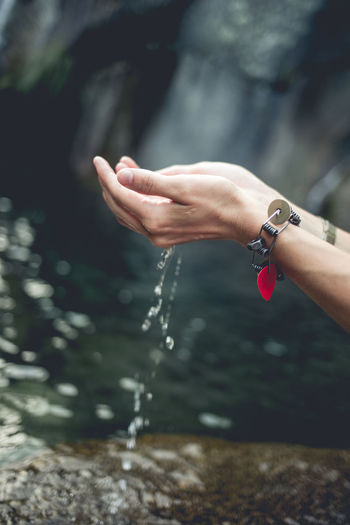 Cropped Hands Of Woman With Water