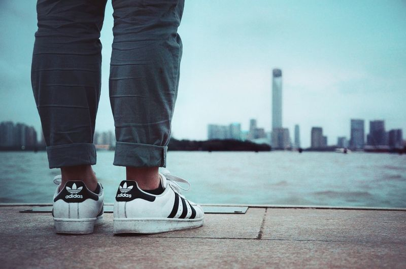 Low Section Human Leg Adults Only Standing One Man Only Human Body Part Outdoors One Person Day Only Men Adult Skyscraper Urban Skyline One Young Man Only People Architecture Young Adult Men City Shoe