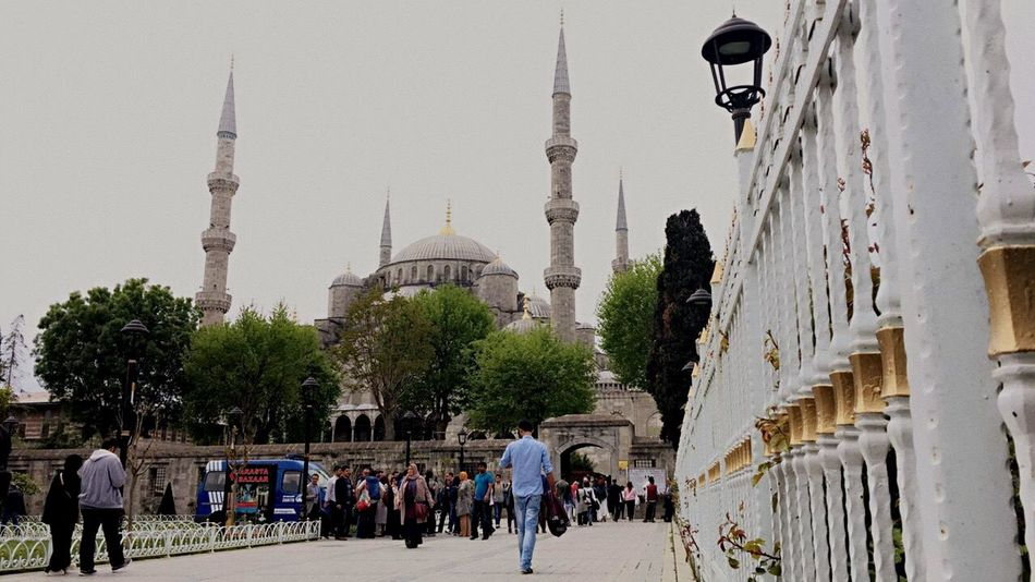 Architecture Built Structure Building Exterior Tourism Mosque Tourist Tower Large Group Of People Walking Famous Place Person Religion Spirituality Place Of Worship City Clear Sky Spire  International Landmark Dome Communications Tower