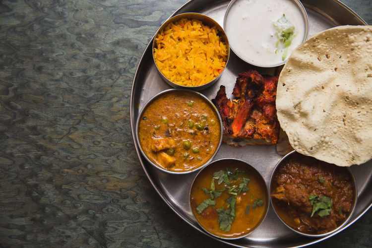 Indian food set Bowl Chicken Tandoori Day Directly Above Food Food And Drink Freshness India Indian Food Indoors  Mutton Curry Nan No People Papadum Plate Pulao Rice Raita Ready-to-eat Rice - Food Staple Serving Size Subji Table