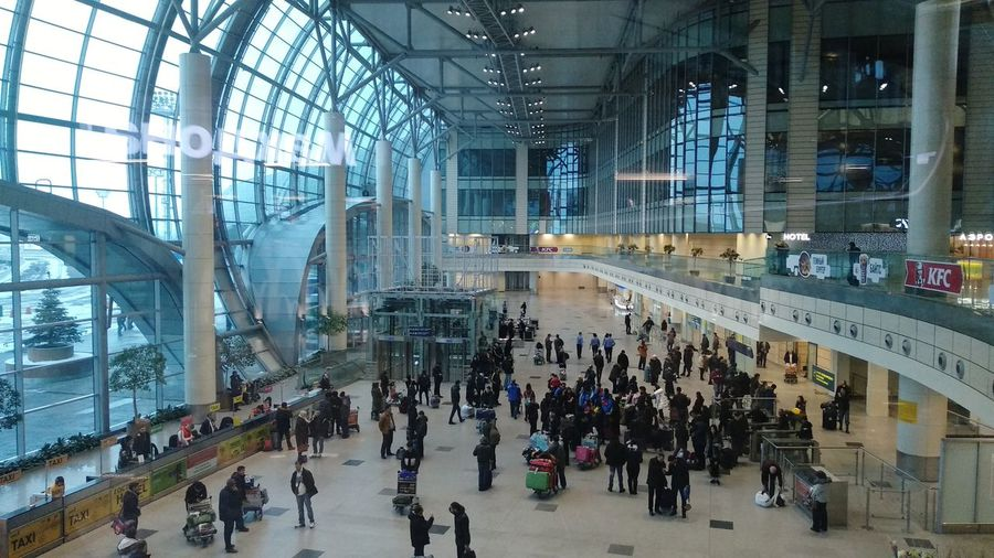 Ice Rink City Modern Men Architecture Built Structure Escalator Transportation Building - Type Of Building Airport Terminal Airport Departure Area Airport Arrival Departure Board Wheeled Luggage