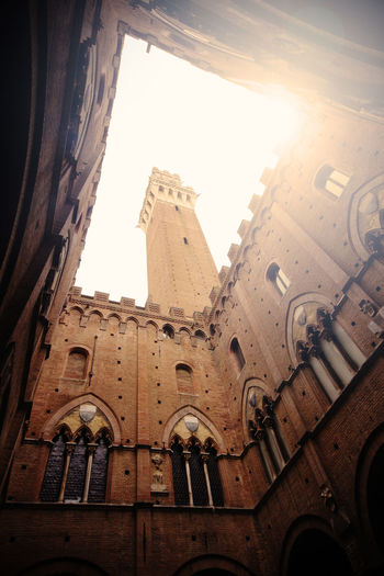 Torre del Mangia in Siena seen from below (low angle view) Torre Del Mangia Siena Tower Low Angle View Tuscany Medieval Architecture Medieval City Cityscape Old Ancient Travel Destinations Landmark Italy High Architecture Building Exterior Built Structure Building No People The Past Directly Below