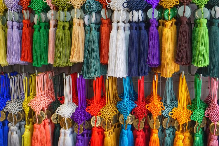 Multi colored decorations hanging in store for sale