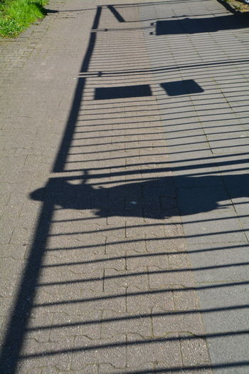 Day Elevated View Focus On Shadow Ground No People Outdoors Shadow Sunlight Sunny The Way Forward Walkway