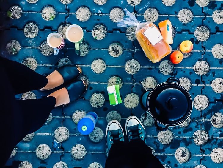 Travelling Travellers Breakfast High Angle View Food And Drink Drink Human Leg One Person Refreshment Human Body Part Real People Blue Table Lifestyles Tea Directly Above Low Section Cup