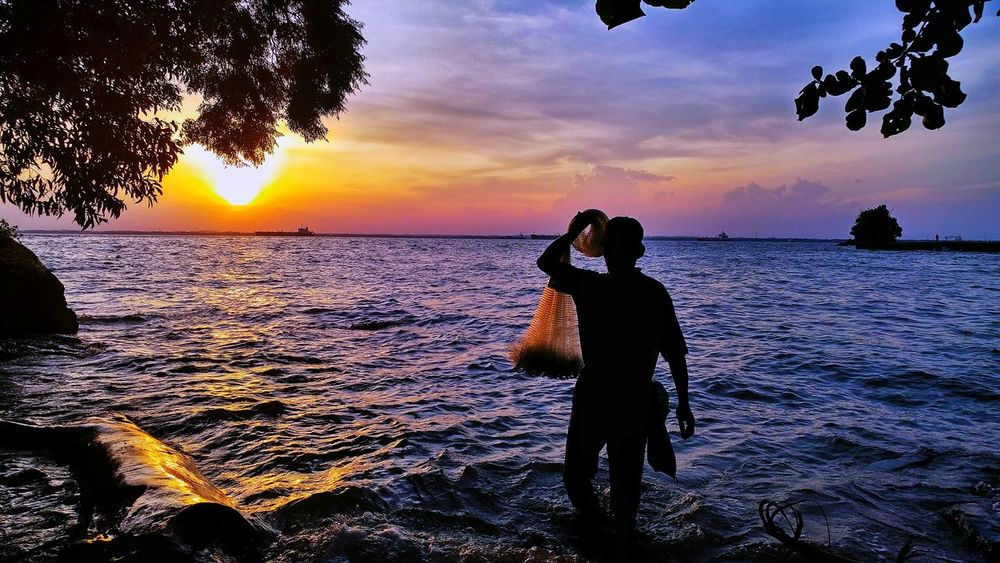Fishing Sunset Sea Silhouette Beach Horizon Over Water Water Sky Outdoors Men People Scenics Nature Adult Beauty In Nature Balikpapan City Balikpapan