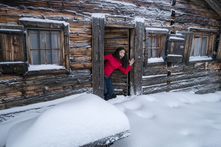 young girl on the skihut Skihütte Skihut Blokhaus Blockhouse Alpin Austria Zillertal Tirol  Bayern Red Color Snow Snowing Cold Temperature Winter Building Exterior Architecture Built Structure Snowflake Ice Crystal Snowball Frost Winter Coat Moments Of Happiness