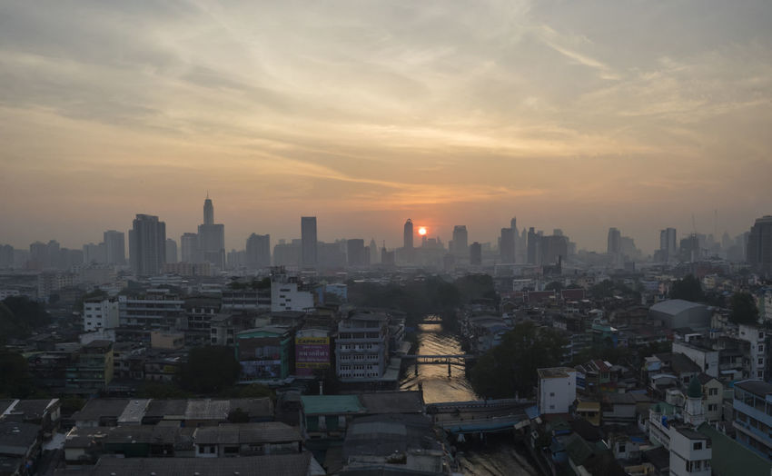 Sunrise over Bangkok City Bangkok Building Exterior Citiscape  City City Life City View  Cityscape Crowded High Angle View Landscape_photography Landscape_Collection Landscapes With WhiteWall Orange Color Residential Building Residential District Residential Structure Sky Skyscraper Sun Sunrise Sunrise_sunsets_aroundworld Sunset Tall - High Tower Urban Skyline