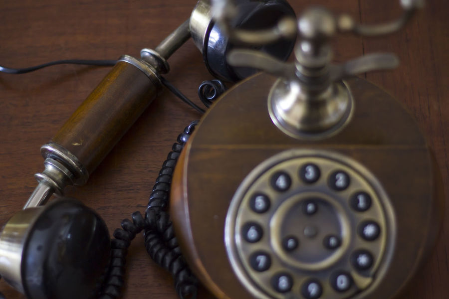 Vintage phone on wooden table with handset down. Top View Antiquated Antique Classic Retro Antique Call Close-up Communication Connection Dial Handset Landline Phone No People Number Old Old Telephone Phone Retro Styled Still Life Style Table Telecommunications Equipment Telephone Vintage Wood - Material