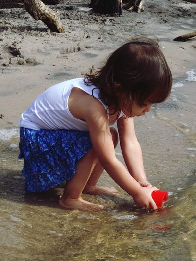 The bay EyeEm Selects 10 Childhood Child Real People Land Beach Girls Lifestyles One Person Sand Leisure Activity Water Women Playing Innocence Hairstyle Nature Day