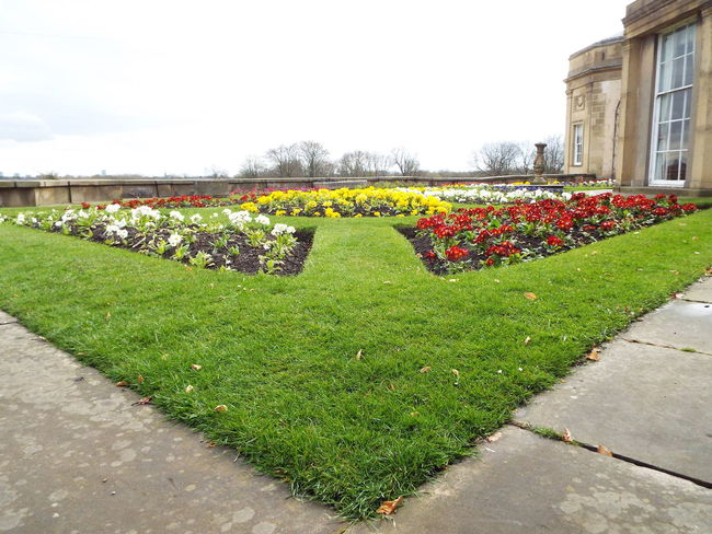Heaton Hall Garden Grass Area Red Flowers White Flowers Blue Flowers Yellow Flowers Outdoors Grey Sky Grass Green Trees