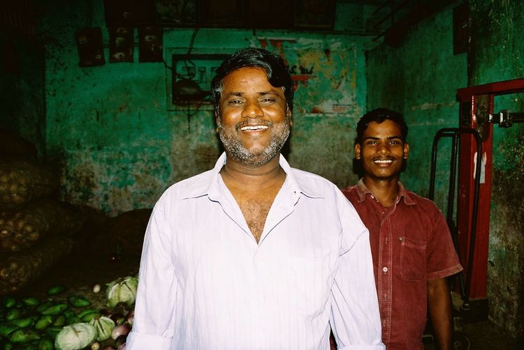 Market stall Analogue Photography Faces Of India Green Wall Market Stall Minolta Dynax 505si People Of India Portrait Through India 2008