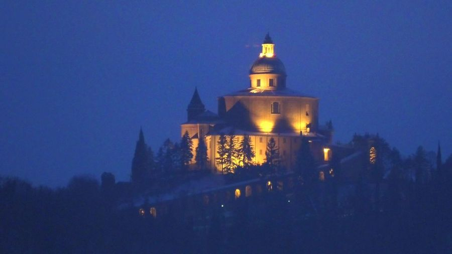 San Luca Sanctuary by night in Bologna city. Historical church and pilgrimage destination in Emilia-Romagna, Italy. Bologna Bologna, Italy Italy San Luca San Luca's Church San Luca Bologna San Luca Skyline Church Cathedral Basilica Night Sunset Religion Dome Madonna Holy Mary Holy Virgin Madonna Di San Luca Dawn Building Exterior Architecture Built Structure Illuminated Building Sky Tree Travel Destinations Nature Clear Sky Travel No People Place Of Worship Tower Plant The Past History Dusk Outdoors Spire