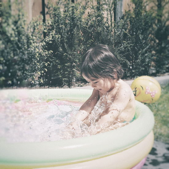 Water Spraying Childhood Motion Enjoyment Fun Wet Splashing Front Or Back Yard Summer Wet Hair Water Drop Swimming Pool Poolside Focus On The Story Moments Of Happiness Analogue Sound