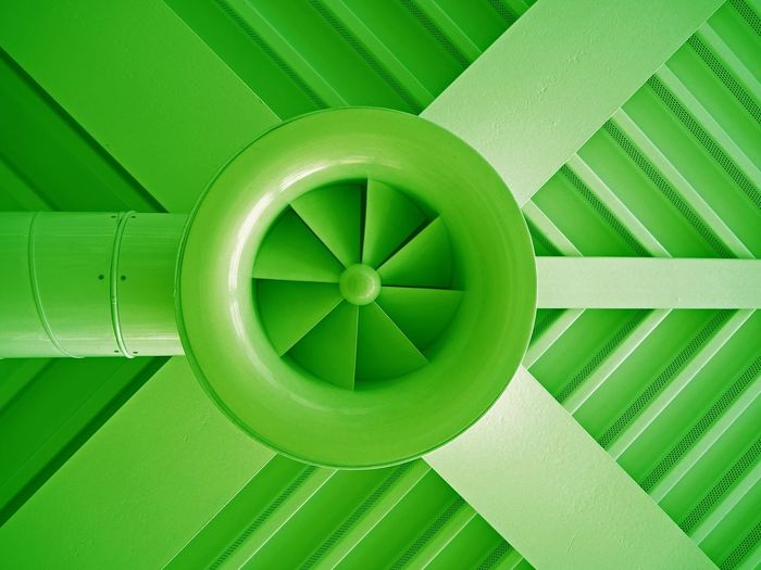 Low Angle View Of Green Air Duct On Ceiling