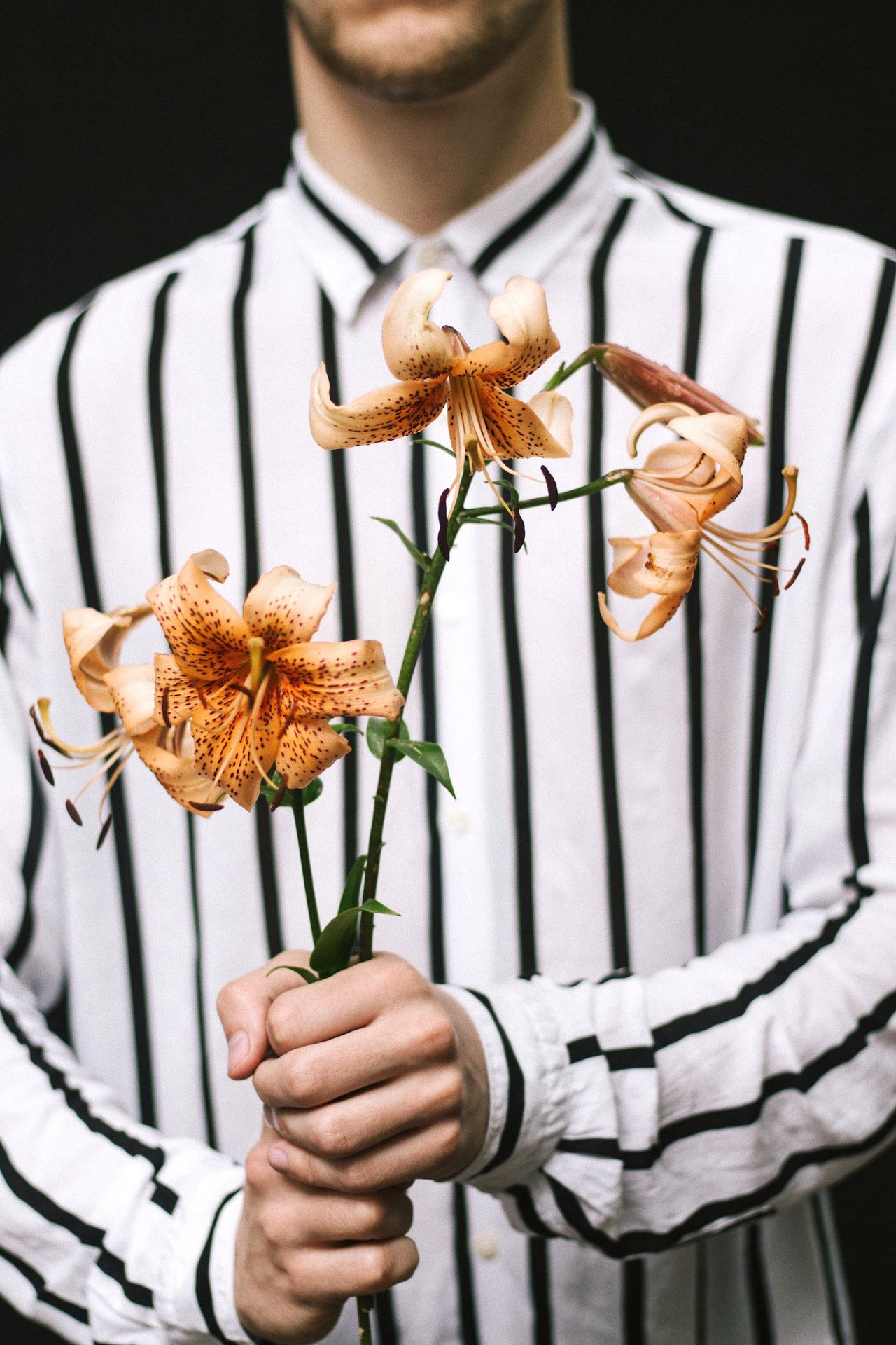 Midsection of man holding flowers
