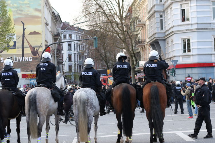 Police Officers In Row On Horses