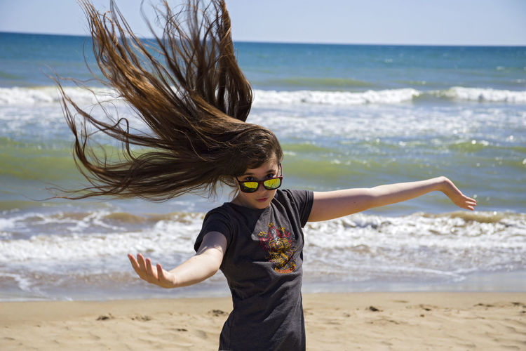 Girl with long flowing hair on the sea shore Beach Beautiful Beauty In Nature Disheveled Girl Leisure Activity Let Your Hair Down Long Hair Long Hair, Don't Care. Nature Ocean Popular Photos Portrait Sand Sea Seaside Shore Summer Sunglasses Sunny Day Vacations Waves Windy Girl Power Feel The Journey
