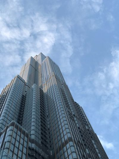 Titles Building Exterior Built Structure Low Angle View Sky City Architecture 17.62° Office Building Exterior Cloud - Sky Tall - High Building Office Tower Modern Skyscraper Outdoors No People Day Travel Destinations First Eyeem Photo