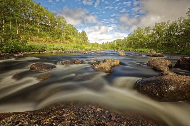 Flowing river Tänndalen Blurred Motion Sweden River Motion Long Exposure Rocks Boulders No People Outdoors Cloud - Sky Nature Landscape Sky Tree