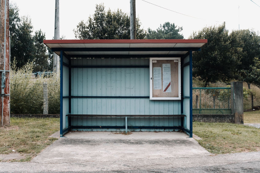 LOST IN GALICIA 🚌 Lostingalicia Threeweeksgalicia Bus Stop Architecture Plant Tree Built Structure Day Building Exterior No People Building Nature Door Closed Outdoors Grass House Land Empty Sky Transportation Garage