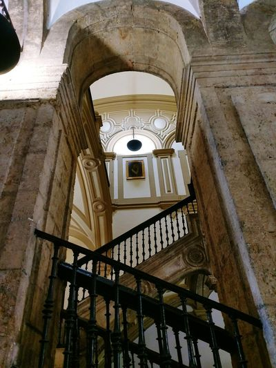 Architecture Built Structure Indoors  No People Low Angle View City Life Tourism Lifestyle Architecturephotography SPAIN Sevilla, España Streetphotography Walking Around Architecturelovers Stairs Turistic Places Andalucía Architecture Low Angle View Arch The Past University Old Buildings Historical Building Perspective