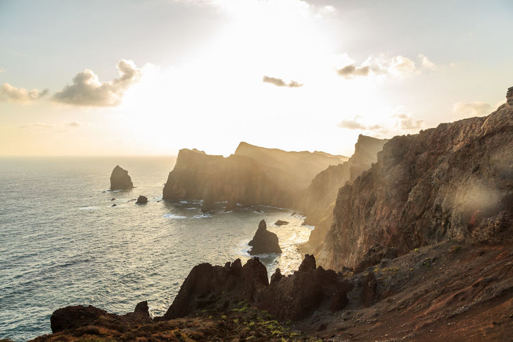 Madeira Island Ponta De São Lourenço Beauty In Nature Cliff Cloud - Sky Formation Land Mountain Nature No People Non-urban Scene Outdoors Rock Rock - Object Rock Formation Scenics - Nature Sea Sky Solid Stack Rock Sunlight Tranquil Scene Tranquility Water