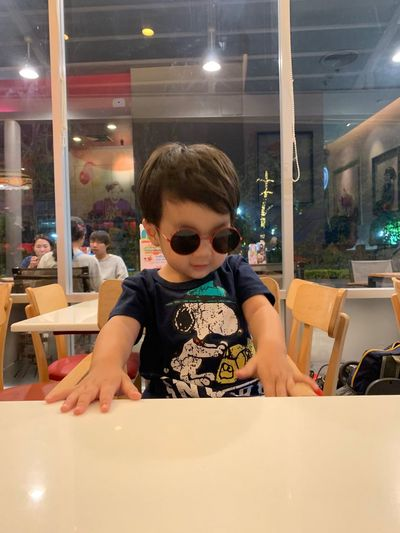 Childhood One Person Portrait Child Restaurant Lifestyles Men Boys Real People Indoors  Casual Clothing Table Males  Leisure Activity Sitting Incidental People Headshot Innocence Hairstyle