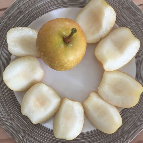 Food And Drink Healthy Eating Nashi Pears Still Life High Angle View Medium Group Of Objects Organic No People Food And Drink Food Indoors  Freshness Close-up Healthy Lifestyle Group Of Objects Fruit Yellow Plate Temptation Vibrant Color Indulgence Fresh