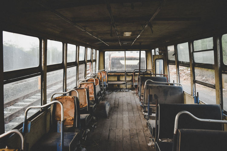 Empty vehicle seats in abandoned bus