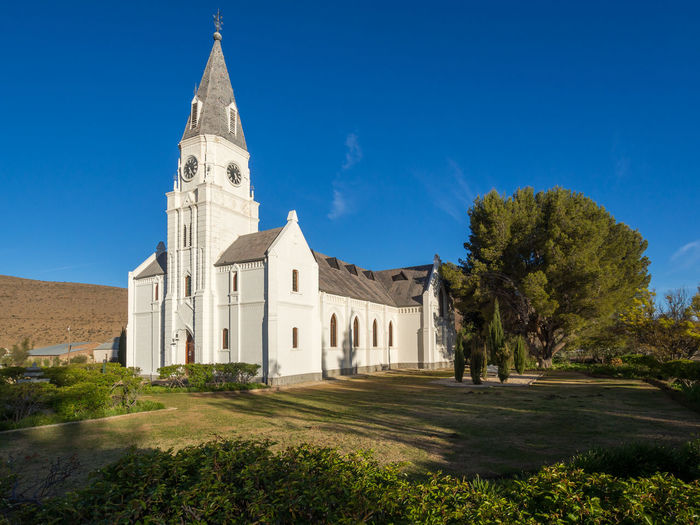 Church Little Karoo South Africa Architecture Blue Building Exterior Built Structure Day Grass History Karoo Nieu-bethesda No People Outdoors Place Of Worship Religion Sky Spirituality Tree