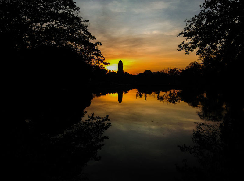 Silhouette reflection in a lake of sunset at Wat Phra Ram in Ayutthaya, Thailand Travel Travel Destinations Ayutthaya Thailand River Orenge Sky Evening Evening Sky Silhouette Wat Temple Twighlight Tree Water Sunset Lake Silhouette Reflection Sky Cloud - Sky Landscape Reflecting Pool Reflection Lake Calm Gold Dramatic Sky Low Tide Tranquil Scene Lakeshore Romantic Sky EyeEmNewHere