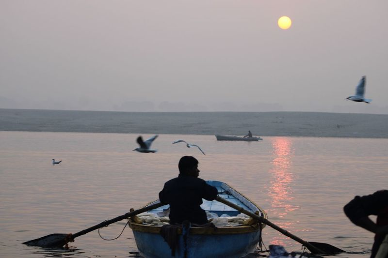 Sunrise & boatmen on the Ganges Water Nautical Vessel Transportation Sky Sea Mode Of Transportation Real People Beauty In Nature Horizon Over Water Silhouette Scenics - Nature